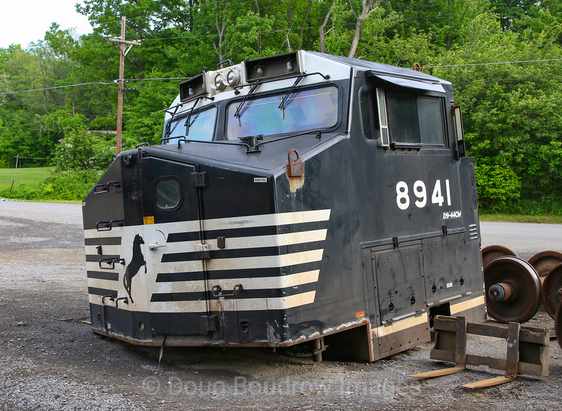 Remains of Dash 9 locomotive cars off of engines that were rebuilt at Juniata Shops in Altoona sit at Cresson Steel in Cresson, 5-26-19.