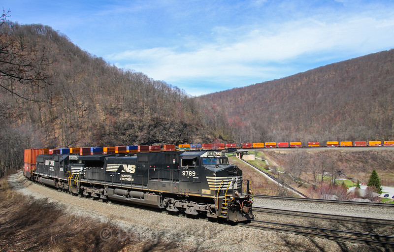 NS Train 21V heads West through the famous Horseshoe Curve. The curve opened February 15, 1854 and was engineered by J. Edgar Thompson. It is located at Kittaning Point, at the base of the Allegheny Mountains. Today it is a national historic landmark, 4-5-17.