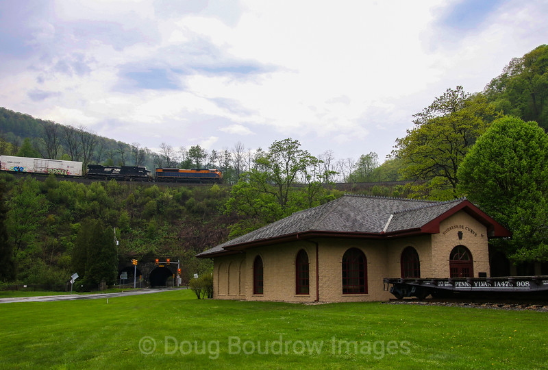 NS mixed freight train 12G heads East through the Horseshoe Curve with the Jersey Central heritage unit leading at Cresson, 5-14-18.