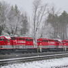 A rare April snowstorm has moved into Cresson on the morning of the 7th. RJ Corman Railroad has come around the wye opposite the Station Inn to pick up a cut of grain cars from Norfolk Southern. They will tie onto a single NS engine for a total of four units on the train, 4-7-17.