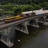 After a lengthy trip from Altoona with a recrew at Banks, Norfolk Southern train 10K is seen crossing the Rockville Bridge in Marysville, PA. We were relaxing on the deck with a couple of beers when we found out this heritage unit was leading the train, so an easy drone flight was able to get the shot. Despite the dreary day, the yellow on the unit showed up nicely, 8-31-20.