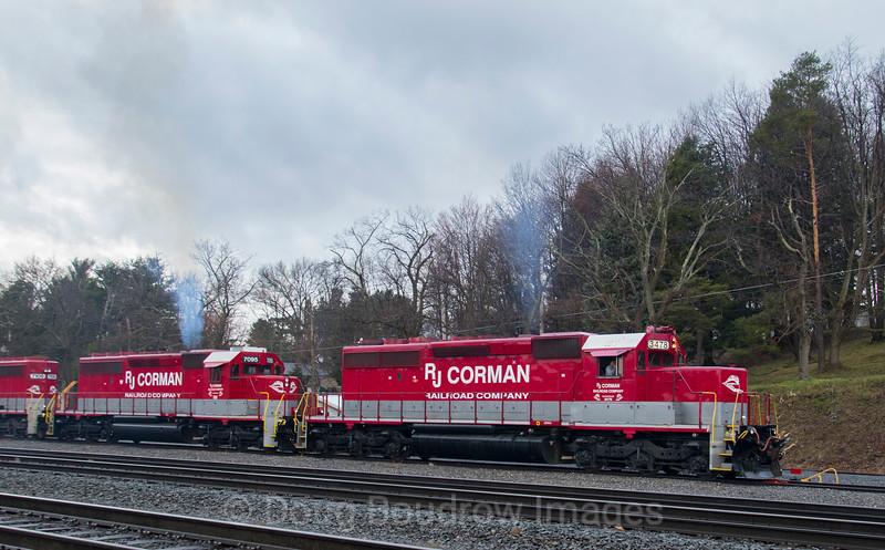 RJ Corman Railroad Company brings a cut of grain cars into the Wye at Cresson, 4-4-17.