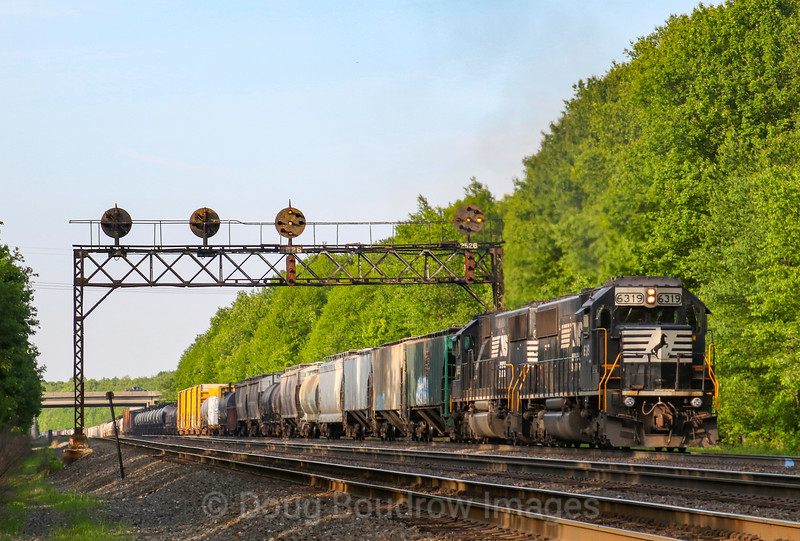An Eastbound manifest grinds up the hill at Cresson with helpers on the rear. The train is seen passing now removed intermediate signals at Milepost 252.6, 5-25-19.