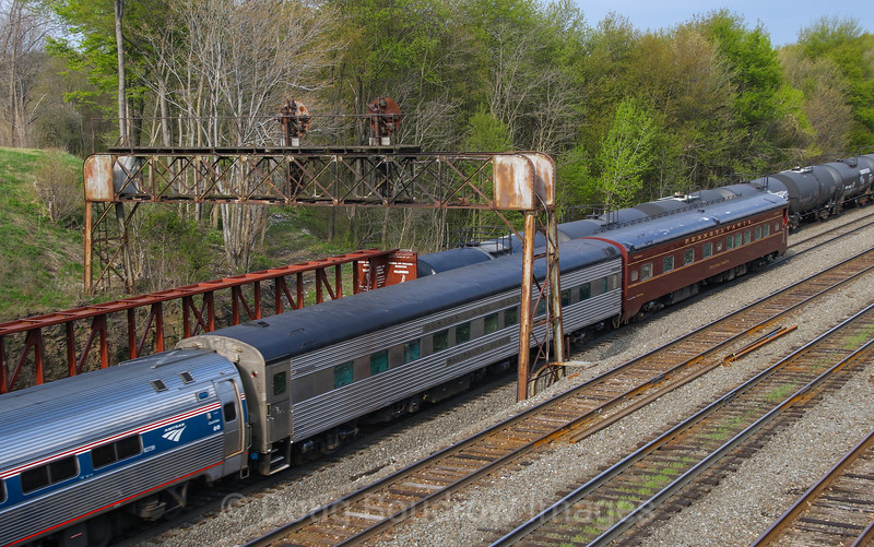 """The Westbound """"Pennsylvanian"""" passes under the old Pennsy signal bridges at Cresson with two private cars on the rear,  5-11-18."""