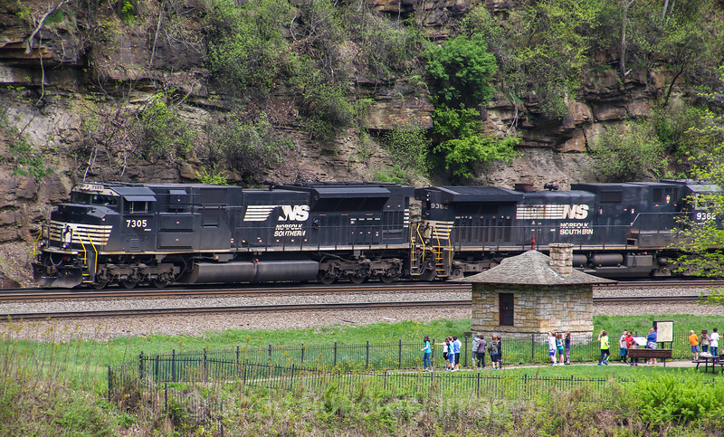 A Westbound NS intermodal train passes through the famous Horseshoe Curve, blowing the horn for an excited group of children on a field trip to the park, 5-11-18.