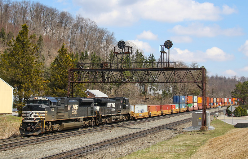 Norfolk Southern priority intermodal train 21V heads West under the automatic signals at Summerhill. The Pennsy era signals are in the process of being replaced for positive train control cab signals, 4-6-19.