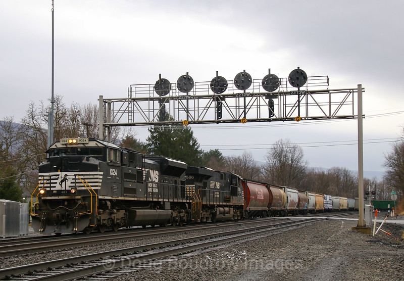 Manifest train 16N heads East under the Conrail era bridge at Antis. This bridge along with the Pennsylvania Railroad CPLs that are mounted on it will be taken down within the next week or two. Their replacement will be modern PTC cab signals, 4-5-19.