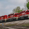 An RJ Corman Railroad Company grain train approaches the NS interchange at Cresson, passing Cresson Steel, 5-14-18.