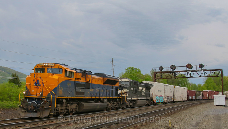 NS train 12G heads East at Tipton after a quick crew change in Altoona with the Central of New Jersey heritage unit leading. The days are numbered for the PRR signals as the implementation of PTC is inevitable, 5-14-18.