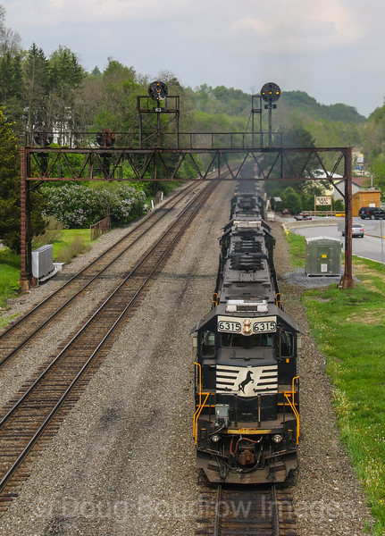 NS coal train 592 gets pushed up the West Slope by a helper set passing under the PRR signal bridge at Summerhill, 5-18-18.