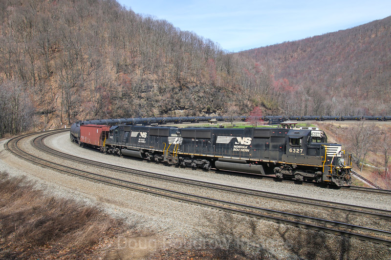 A pair of helpers shove crude oil train 16G around the Horseshoe Curve, 4-5-17.