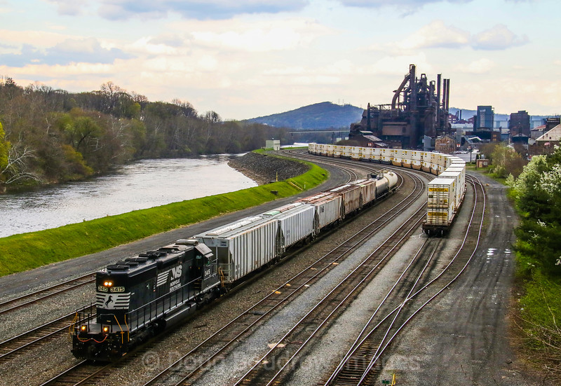An NS local passes the former Bethlehem Steel foundry along the Lehigh River in Bethlehem, PA, 4-28-18.
