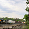 NS mixed freight train 12G heads East up the West Slope of the Allegany Mountains with the Jersey Central heritage unit leading at Cresson, 5-14-18.