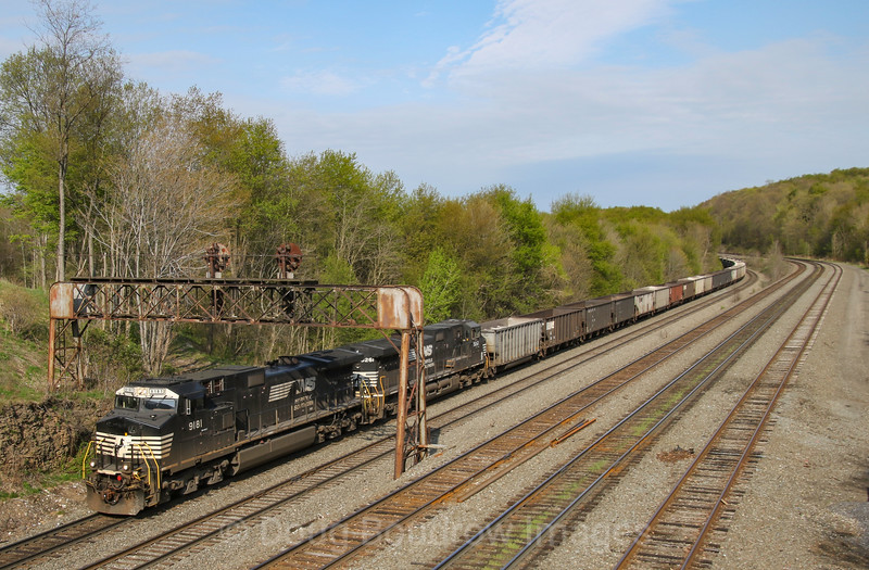 A Westbound empty coal train heads under Route 53 in Cresson passing under the old Pennsy signals, 5-11-18.
