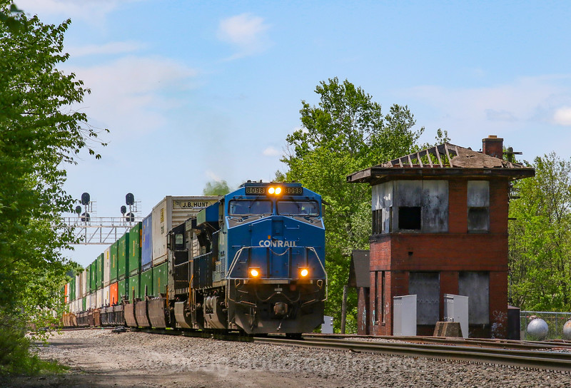 The Conrail heritage unit leads an Eastbound intermodal past AR Tower in Gallitzin, 5-24-19.