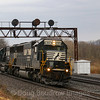 A helper set heads East through Tipton, under the automatic signals that will soon be removed in favor of a modern setup. The set is headed to meet a struggling 25V that lost power on one of its units East of Huntingdon. The helpers will intercept the 25V just East of this photo location, 4-5-19.