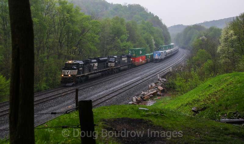 "NS Train 23M races the Amtrak ""Pennsylvanian"" down the West Slope at Cassandra, 5-13-18."