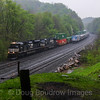 """NS Train 23M races the Amtrak """"Pennsylvanian"""" down the West Slope at Cassandra, 5-13-18."""