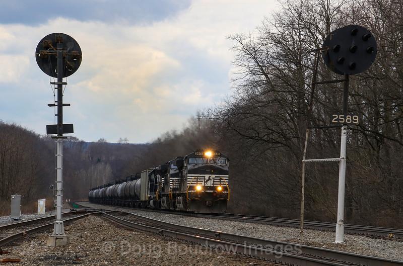 Loaaded tank train 64R passes Portage headed East, 4-6-19.