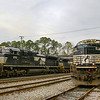 An NS intermodal train with an SD70 ACe leader arrives in North Charleston passing a tied down sister locomotive at the North end of the yard, 3-1-19.