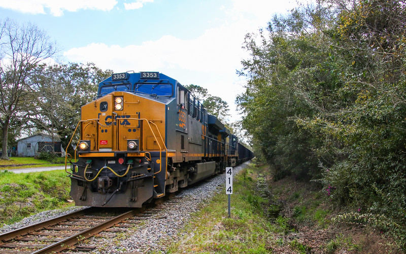 CSX Local F730 is seen bringing loaded coal hoppers through North Charleston, 2-29-20.