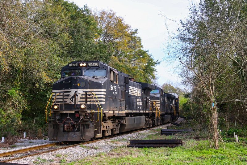 An autorack train is pulled out of the Port of Charleston, headed North out of the downtown area, 3-2-19