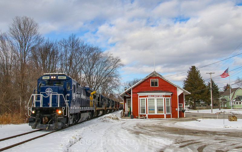 Since a recent collapse has closed the Hoosac Tunnel for an indefinite amount of time, Pan Am and Pan Am Southern are detouring their manifest trains over Vermont Rail Systems trackage. On February 17th train 11R is seen passing the former Wallingford, VT depot which has been converted into the town fire station, 2-17-20.