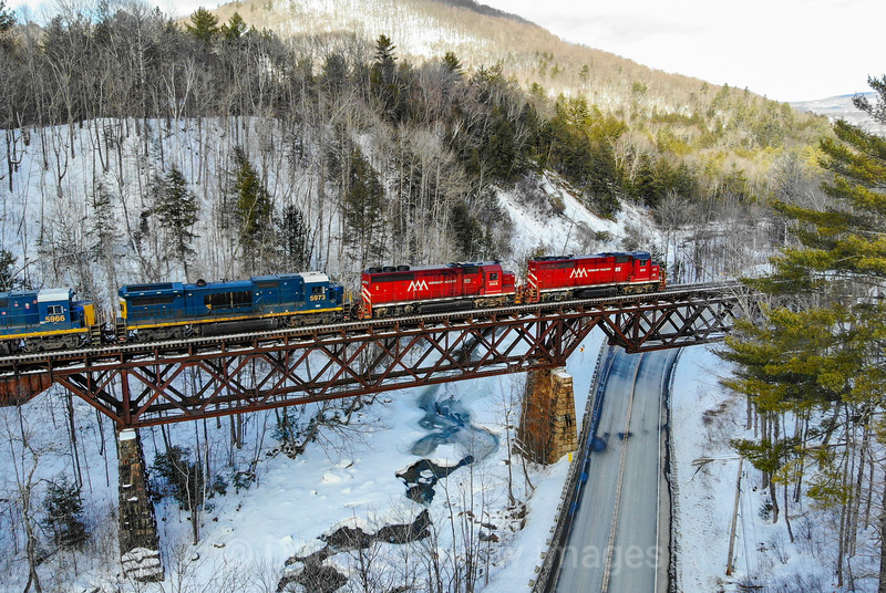 Since a recent collapse has closed the Hoosac Tunnel for an indefinite amount of time, Pan Am and Pan Am Southern are detouring their manifest trains over Vermont Rail Systems trackage. On February 17th train 11R is seen passing Cuttingsville with Vermont Rail Systems power leading, 2-17-20.