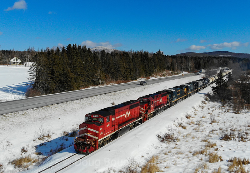 Since a recent collapse has closed the Hoosac Tunnel for an indefinite amount of time, Pan Am and Pan Am Southern are detouring their manifest trains over Vermont Rail Systems trackage. On February 17th train 11R is seen passing Mount Holly with Vermont Rail Systems power leading, 2-17-20.