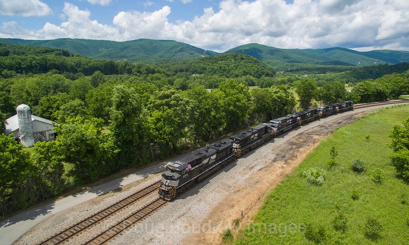 Westbound power move 961 with the lead unit proudly flying Old Glory passes Singer, 5-28-17.