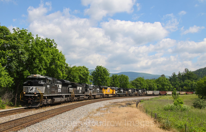 Westbound train 823 heads from Norfolk, VA to Williamson, WV with a load of empty coal hoppers. The NS 1030 which was the final heritage unit that NS did is the leader. Although this engine does not have a special paint job, the number 1030 was done to signify 30 years of Norfolk Southern, 5-26-17.