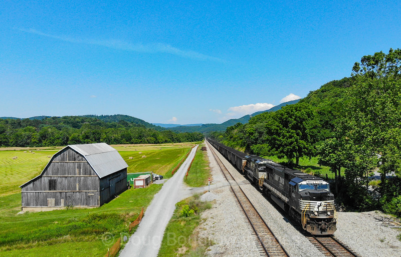 """Norfolk Southern coal train 820 is seen passing the location the railroad refers to as """"Kumis."""" This line, which is the Norfolk Southern Whitethorne District was once the Virginian Railway. NS typically uses this line to run heavy Eastbound manifest and unit trains as the grade is less severe than the grade on the Christiansburg District, 7-3-20."""