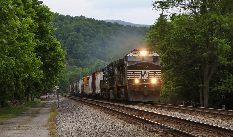 Westbound manifest train 15T passes Elliston, 5-28-17.
