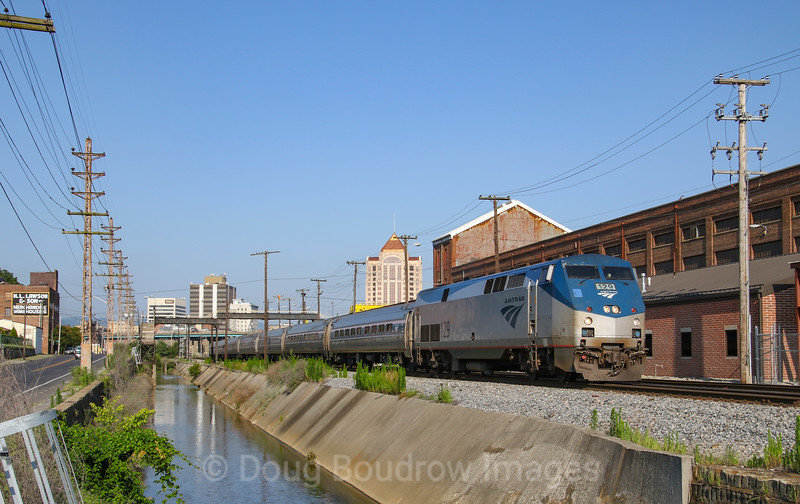 Amtrak Regional train 156 is seen departing Roanoke and passing the old N&W East End Locomotive Shops, 7-4-20.