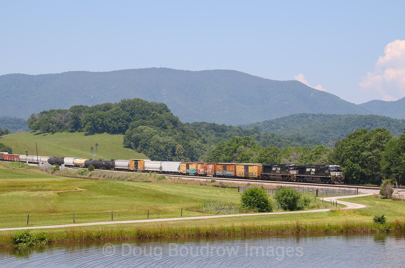 Norfolk Southern manifest train 18T is seen passing the Norfolk & Western color position light signals at Arcadia passing through Solitude Farms on. beautiful Fourth of July morning, 7-4-20.