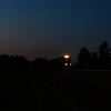 As the last light fades behind the Blue Ridge Mountains, NS train 15T heads West through John Farm in Shawsville, 7-3-20.