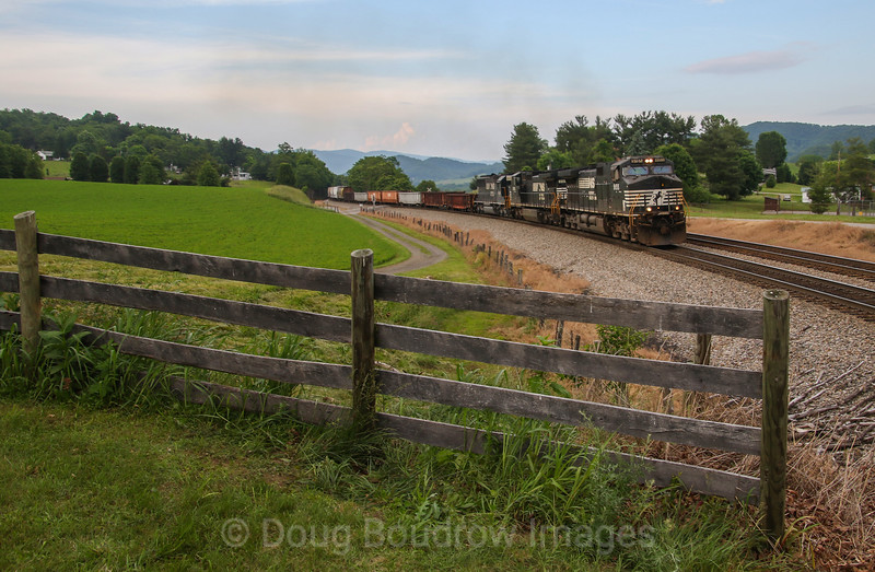 NS manifest train 189 (Crewe, VA to Bellevue, OH) passes John Farm in Shawsville grinding up the grade of Christiansburg Mountain, 5-27-17.