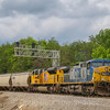 A Southbound loaded grain train passes through Wirtz with foreign power, 5-25-17.
