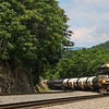 A Westbound loaded ethanol train is seen slowly grinding up Christiansburg Grade in SHawsville, Virginia, 7-3-20.