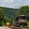 A Westbound loaded ethanol train is seen passing through Elliston, Virginia on Main 1. On Main 2 a Herzog work crew can be seen putting their train in the siding as they finish their workday, 7-3-20.