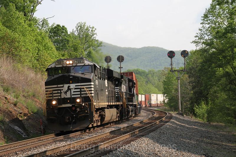 A double stack intermodal train climbs the steep grade at Blue Ridge, 5-8-16.