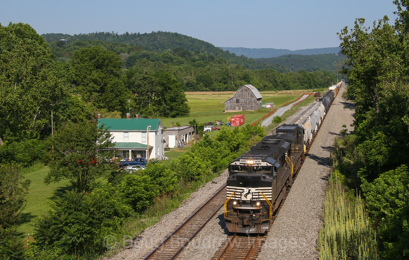 """Norfolk Southern manifest train 18M (Elkhart, Indiana to Linwood, North Carolina) is seen passing the location the railroad refers to as """"Kumis."""" This line, which is the Norfolk Southern Whitethorne District was once the Virginian Railway. NS typically uses this line to run heavy Eastbound manifest and unit trains as the grade is less severe than the grade on the Christiansburg District, 7-3-20."""
