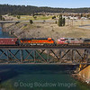 The DPUs on a Westbound BNSF grainer are seen crossing the Spokane River coming into Spokane, 4-6-21.