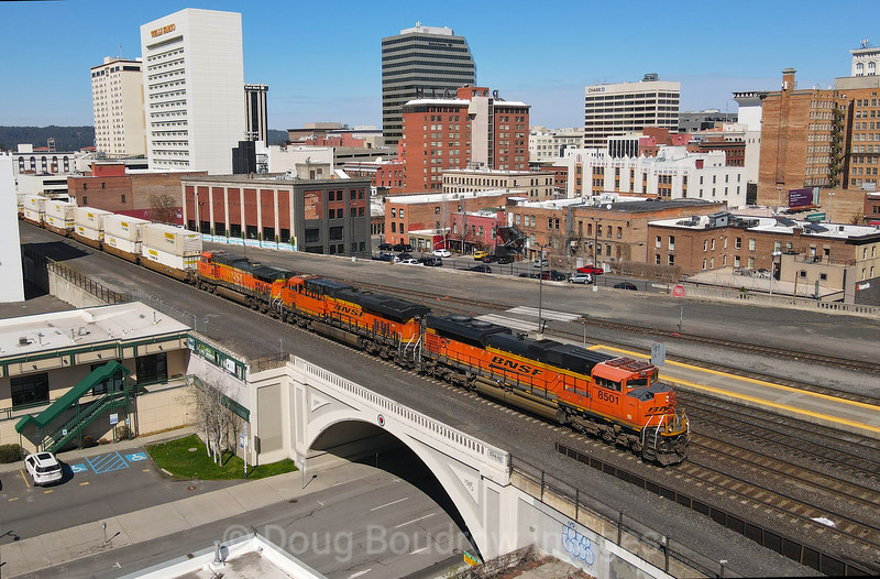 A priority intermodal Q train is seen passing on the elevated grade through downtown Spokane, 4-12-21.