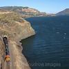 BNSF coal train C-SXMRBG is seen along the basalt cliffs at Lyle along the Columbia River Gorge, 7-15-21.
