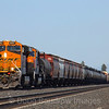 A Westbound BNSF manifest freight is seen crossing from Idaho into Washington, 4-6-21.