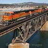 A Westbound BNSF ballast train is seen crossing the Spokane River coming into Spokane, 4-6-21.