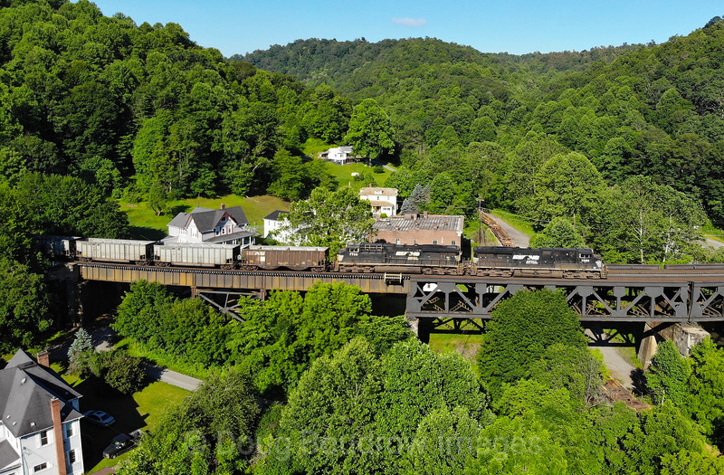 NS empty coal train 823 is seen headed West over Coopers Trestle in Bramwell on a beautiful summer morning, 7-2-20.