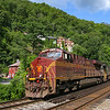 On a day trip to the Norfolk Southern's famed Pocahontas Division, we visited a few of the popular locations. After waiting for several hours to get a train at the signature shot crossing Tug Fork coming out of Welch Tunnel, we heard Westbound empty grainer 51E call the signals at Welch. Being way out of cell phone range we had no idea the PRR heritage unit was leading. We were very happily surprised to see a Tuscan Red nose emerge from the bore, 7-2-20.
