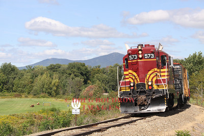 #573, a former Maine Central GP-7 pulls a mixed freight extra into Conway, 9-18-10.